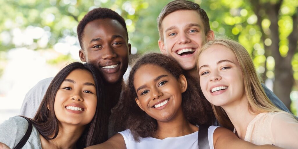 diverse group of happy youth