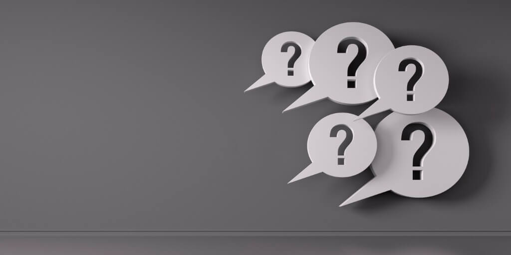 Holding difficult conversations image with question marks in speech bubbles