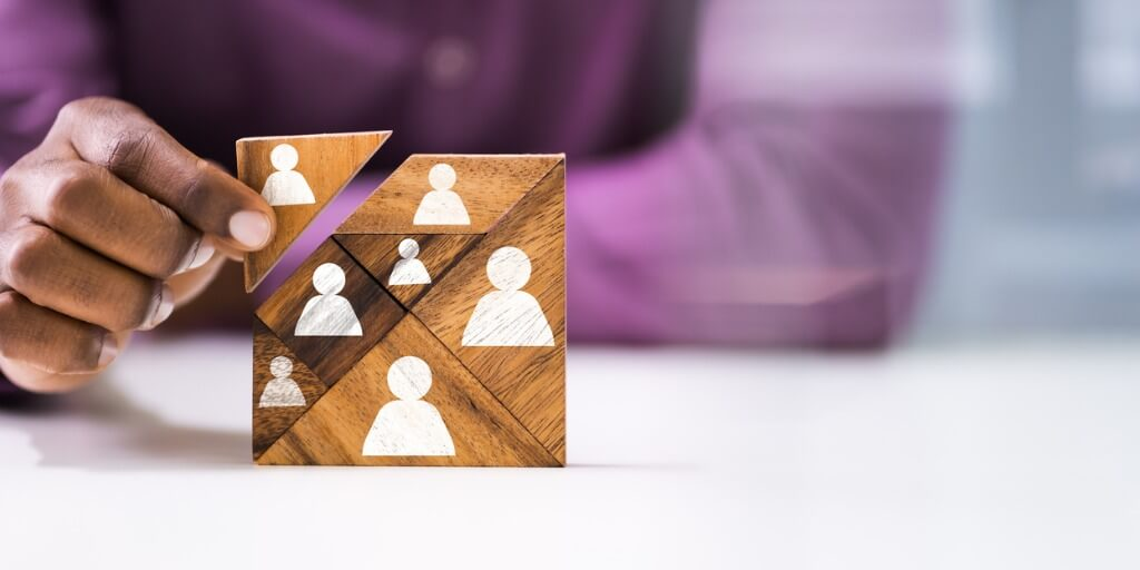 Cultivating credibility and influence showing person building blocks representing support team