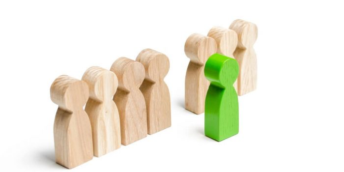 image showing row of pegs with one green peg in front representing a leader