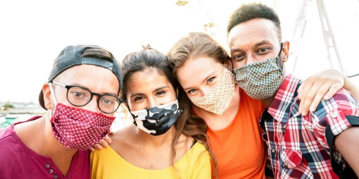 Standing up to COVID image of group of happy youth wearing mask