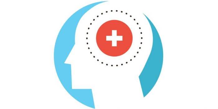 silhouette of human head with first aid symbol