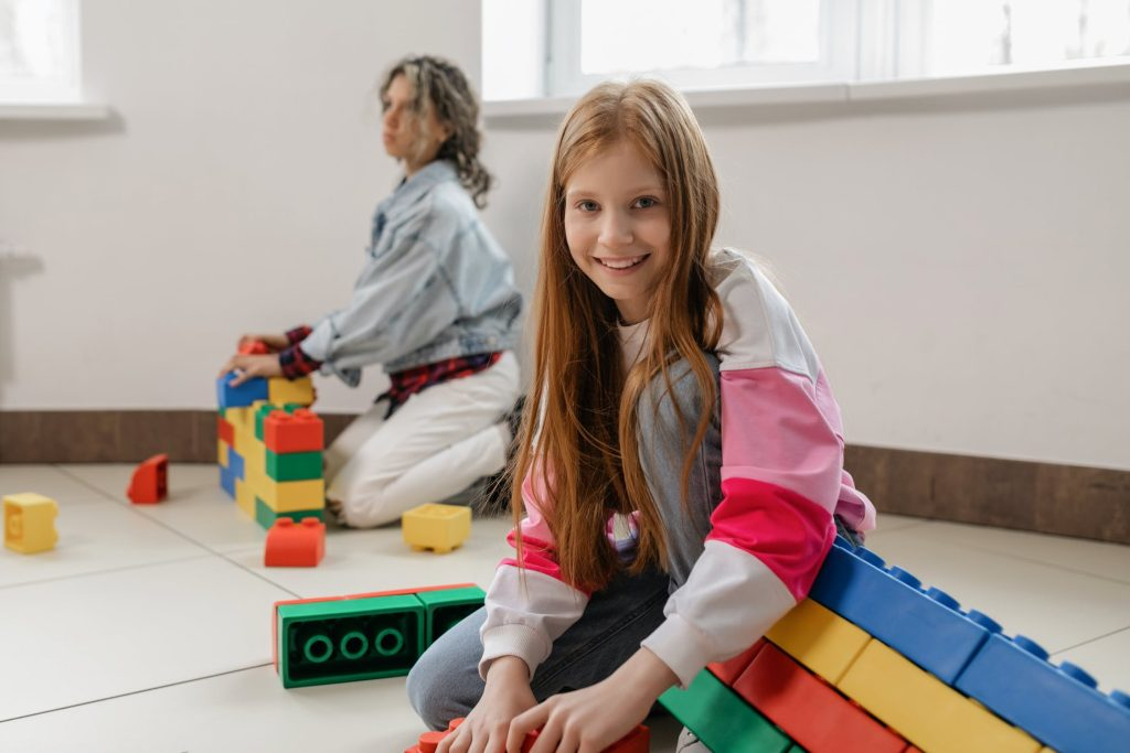 Girl plays blocks